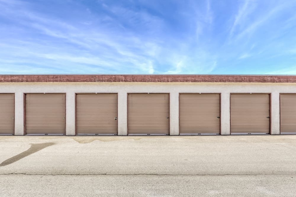 Exterior storage units with beige doors at Crown Self Storage in N Las Vegas, Nevada