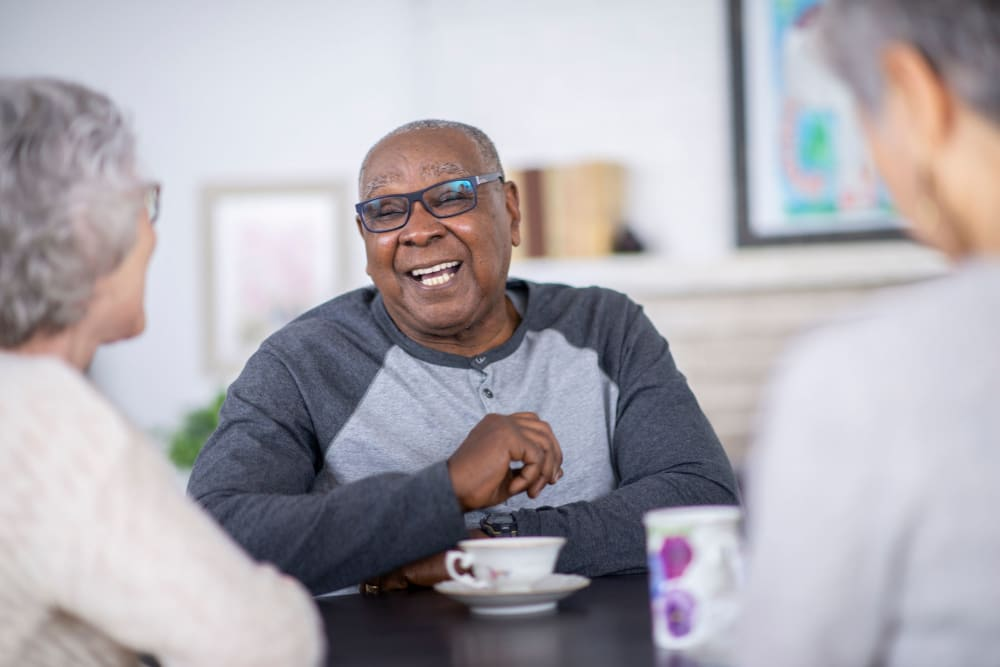 Resident enjoy tea at Ramsey Village Continuing Care in Des Moines, Iowa