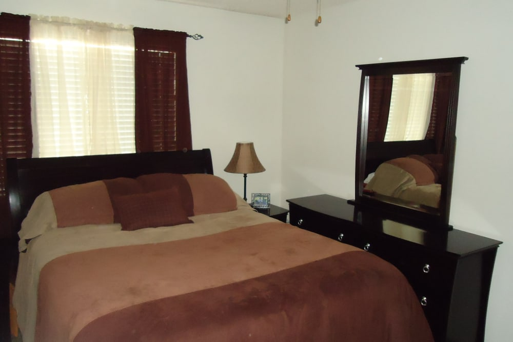 Cozy bedroom at Olympus Court Apartments in Bakersfield, California