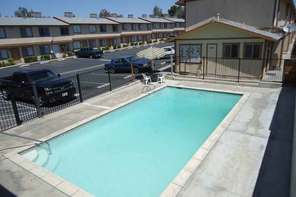 Clean blue swimming pool at Olympus Court Apartments in Bakersfield, California