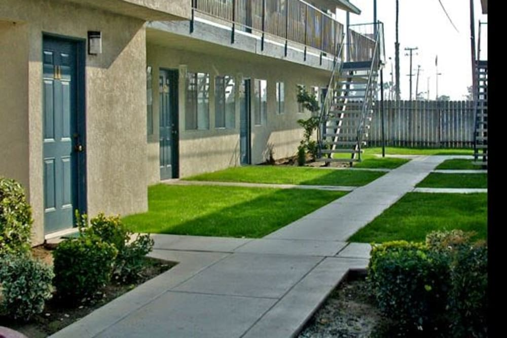 Outdoor walkways at El Potrero Apartments in Bakersfield, California