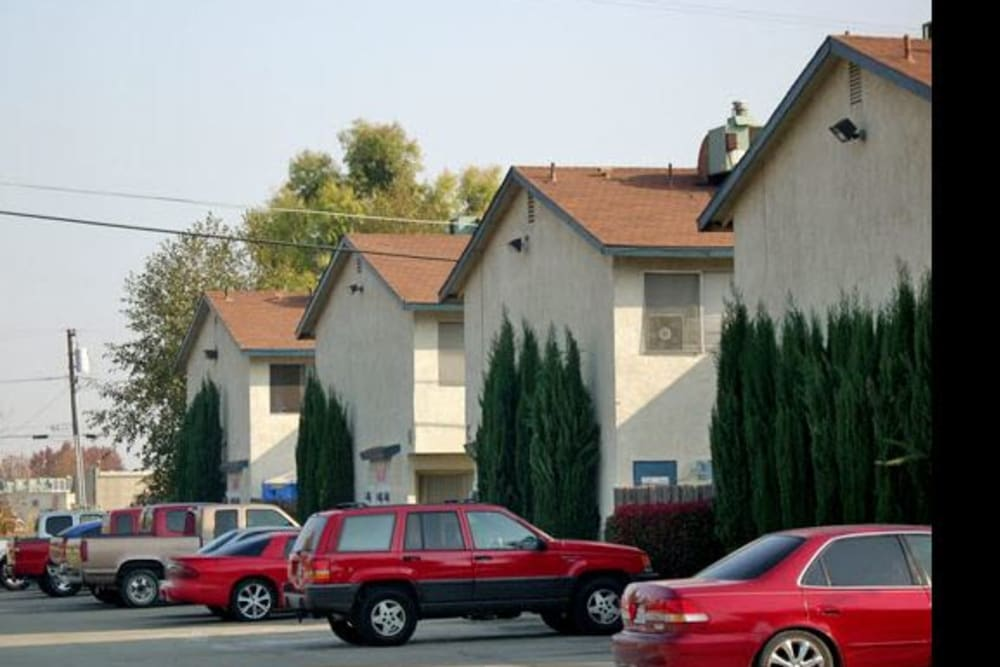 Parking spaces and housing at El Potrero Apartments in Bakersfield, California