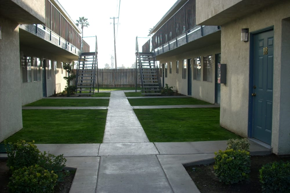 Sidewalks between housing at El Potrero Apartments in Bakersfield, California