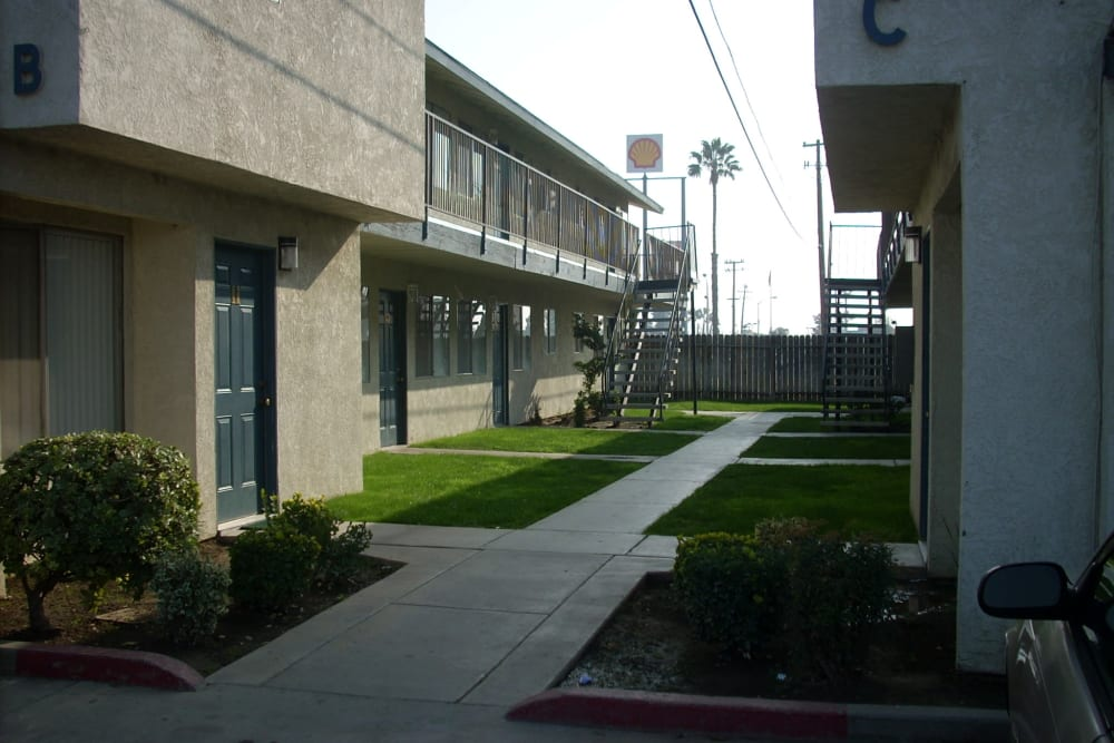 Outdoor paths at El Potrero Apartments in Bakersfield, California