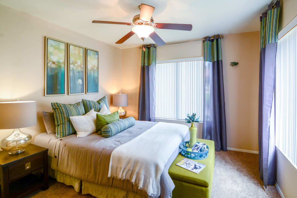 Bedroom with green accents at The Palms on Scottsdale in Tempe, Arizona