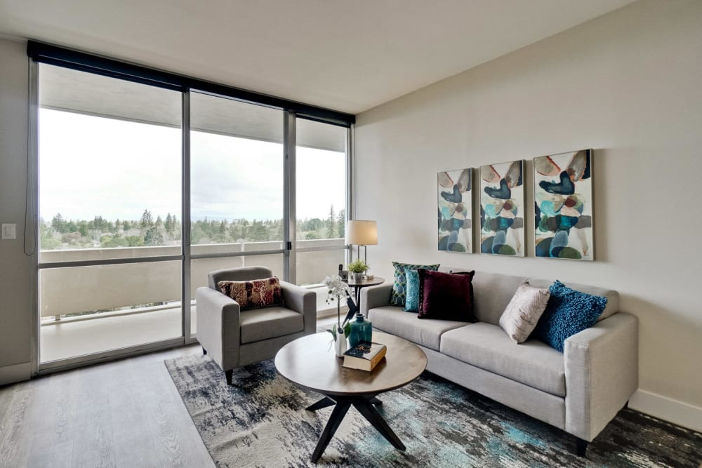 Apartments with a luxury living room with sliding glass door to private balcony at The Marc, Palo Alto