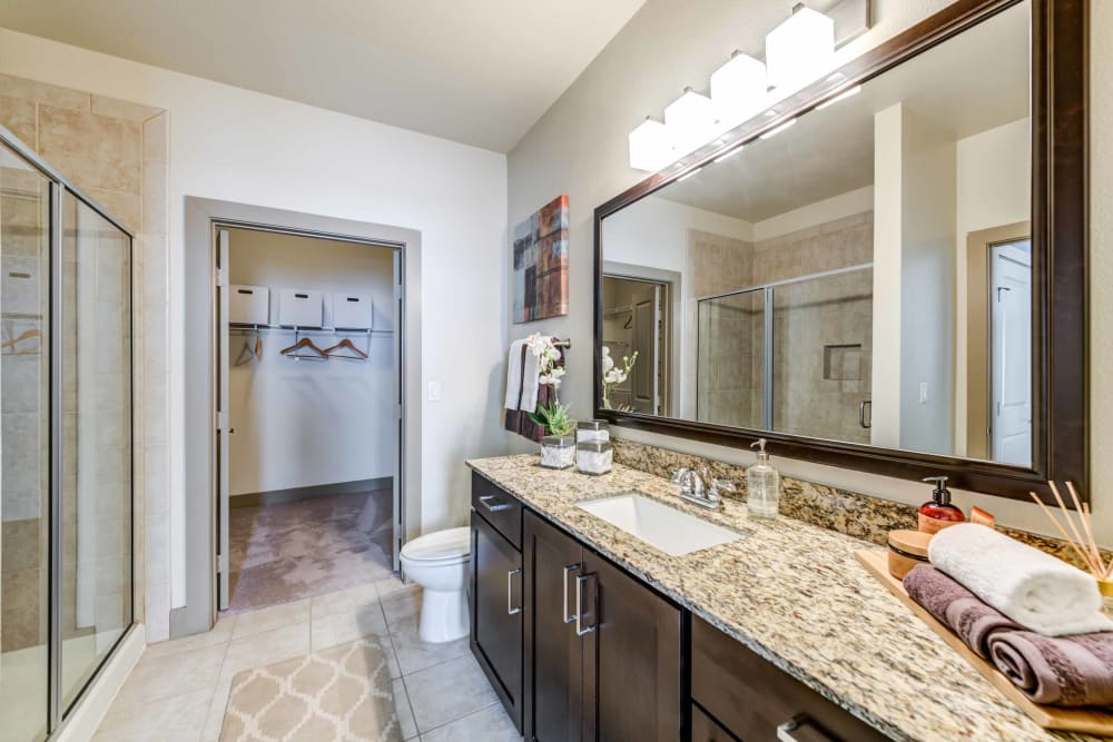 Beautiful spacious bathroom with marble counters at Terrawood in Grapevine, TX