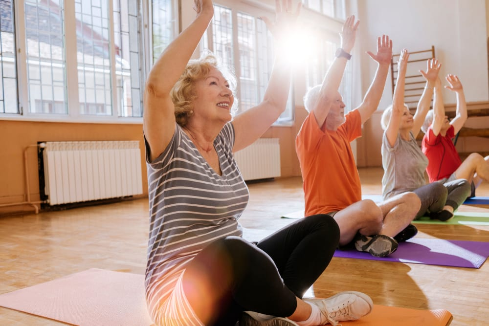 Residents at a yoga class at Arlington Place Oelwein in Oelwein, Iowa