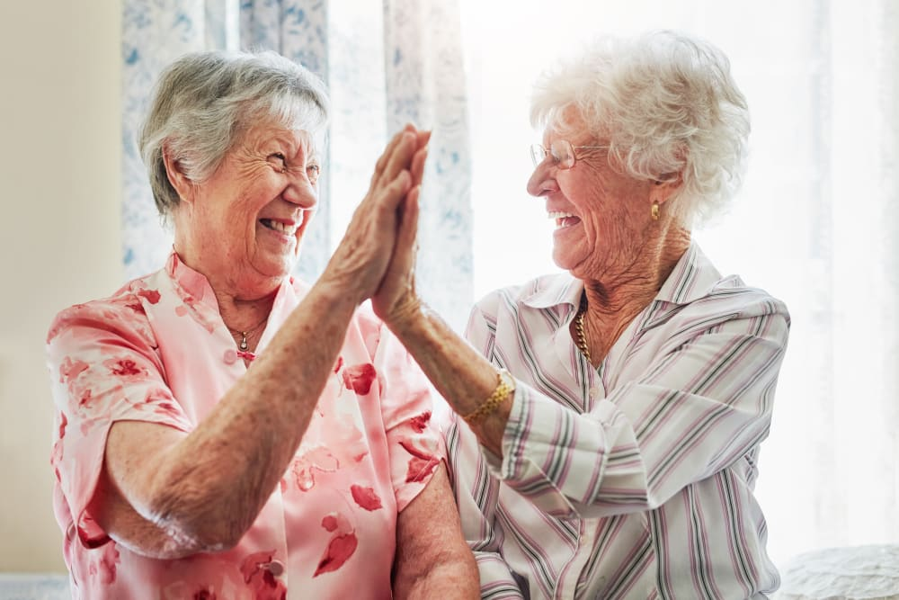 Residents high-fiving at Harmony Place in Harmony, Minnesota