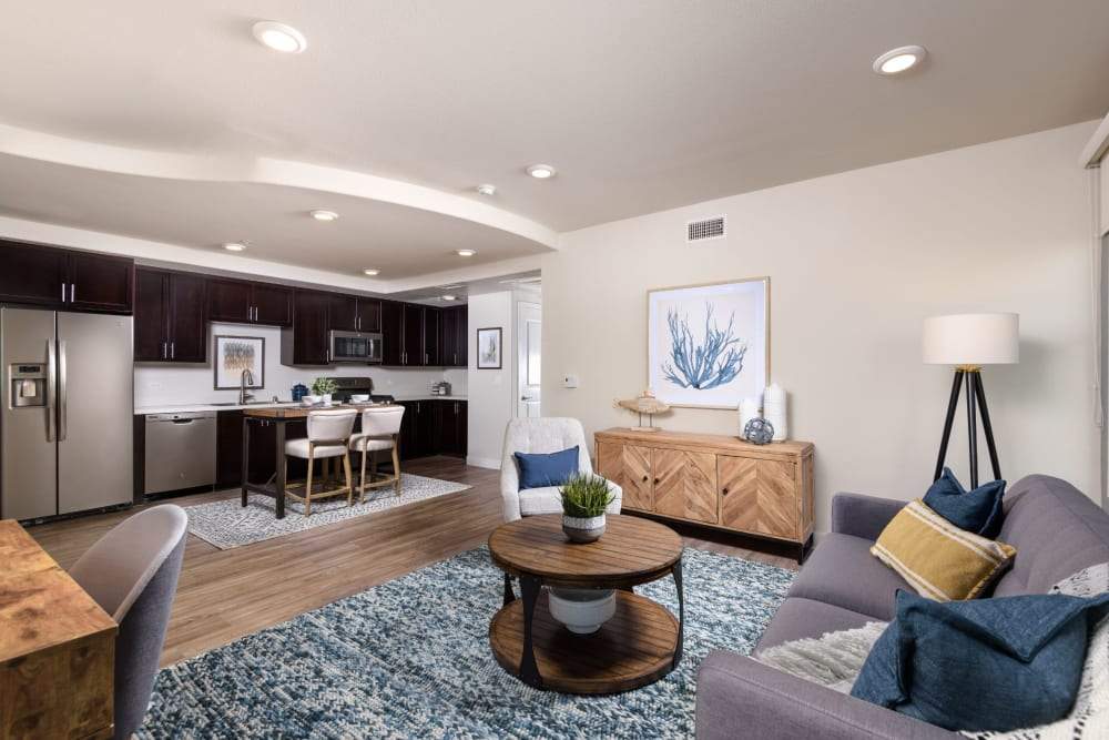 Spacious open-concept floor plan with modern furnishings in a model home at Portside Ventura Harbor in Ventura, California