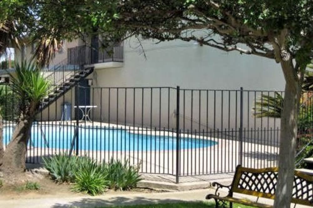 View of the pool through the gate at Highland View Court in Bakersfield, California