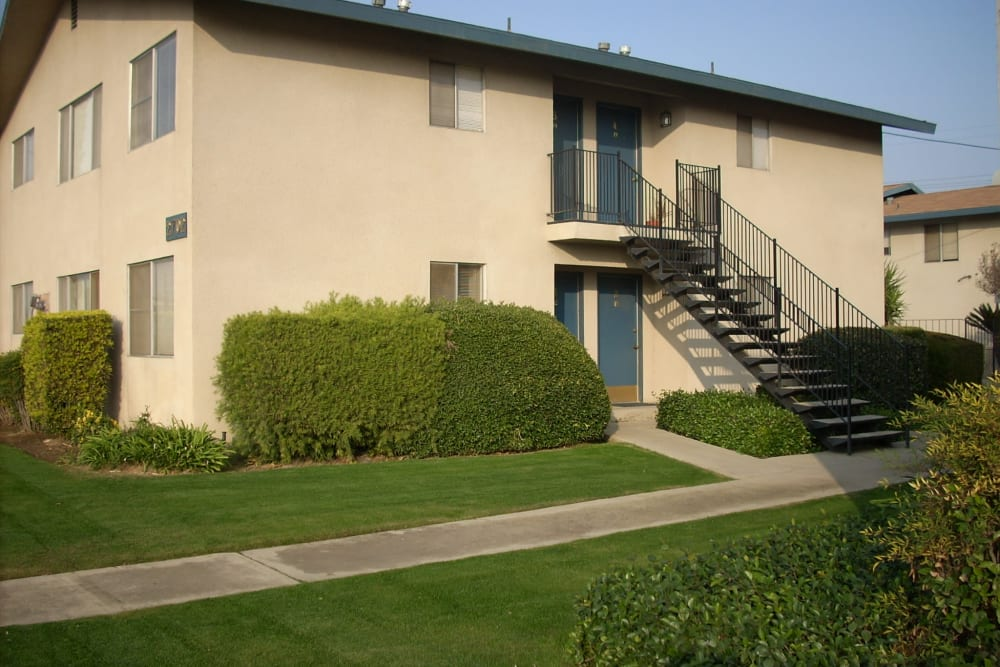 Exterior view of stairwell and impeccable landscape at Highland View Court in Bakersfield, California