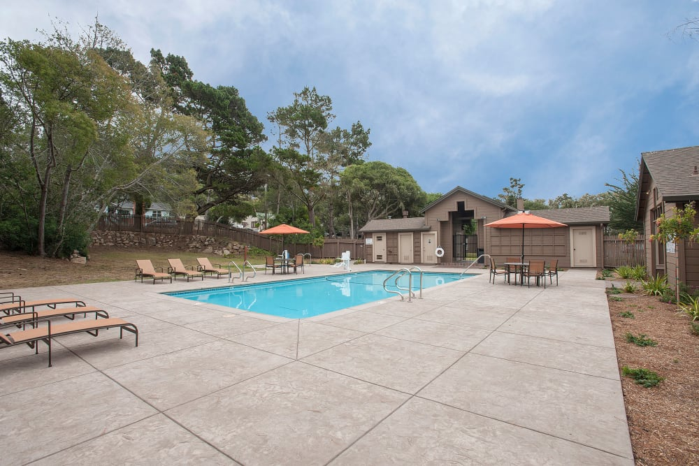 Spacious pool and surrounding area at Seventeen Mile Drive Village Apartment Homes in Pacific Grove, California