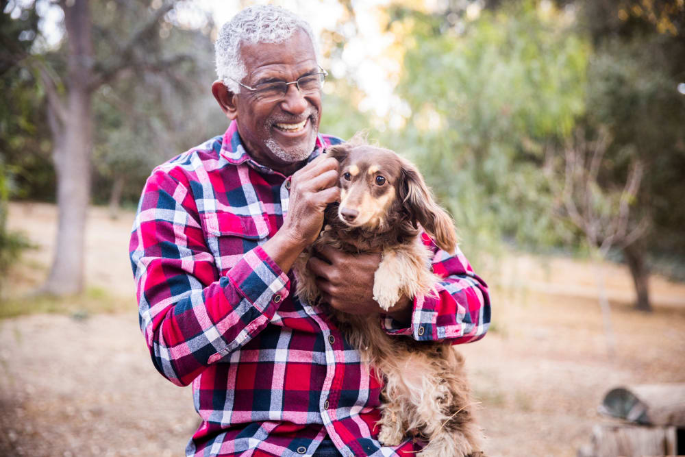 A resident with his dog at a Merrill Gardens community.