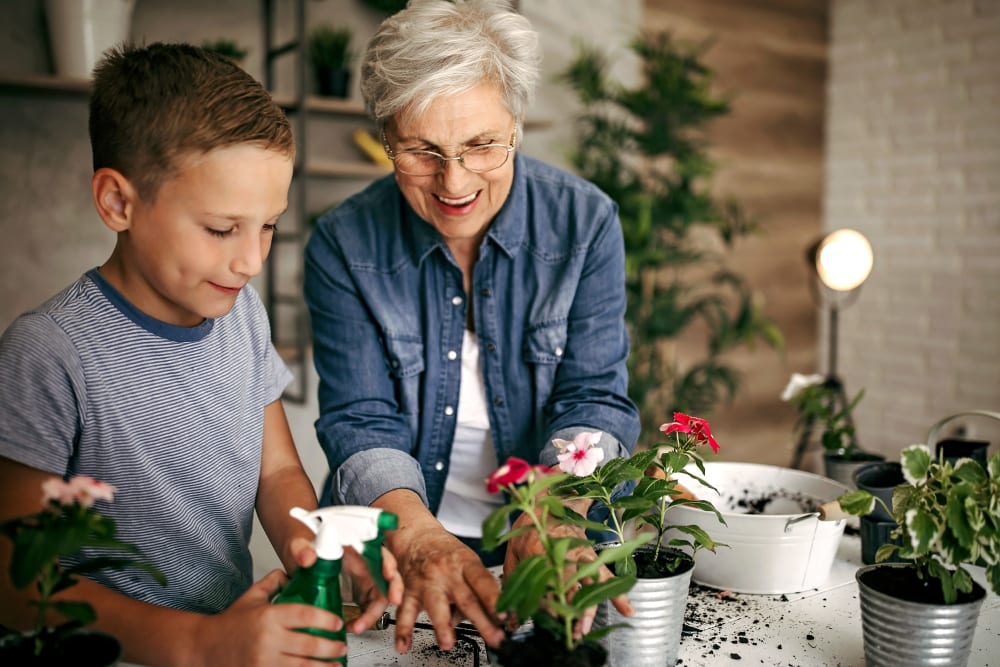 A resident and her grandchild gardening at Merrill Gardens.