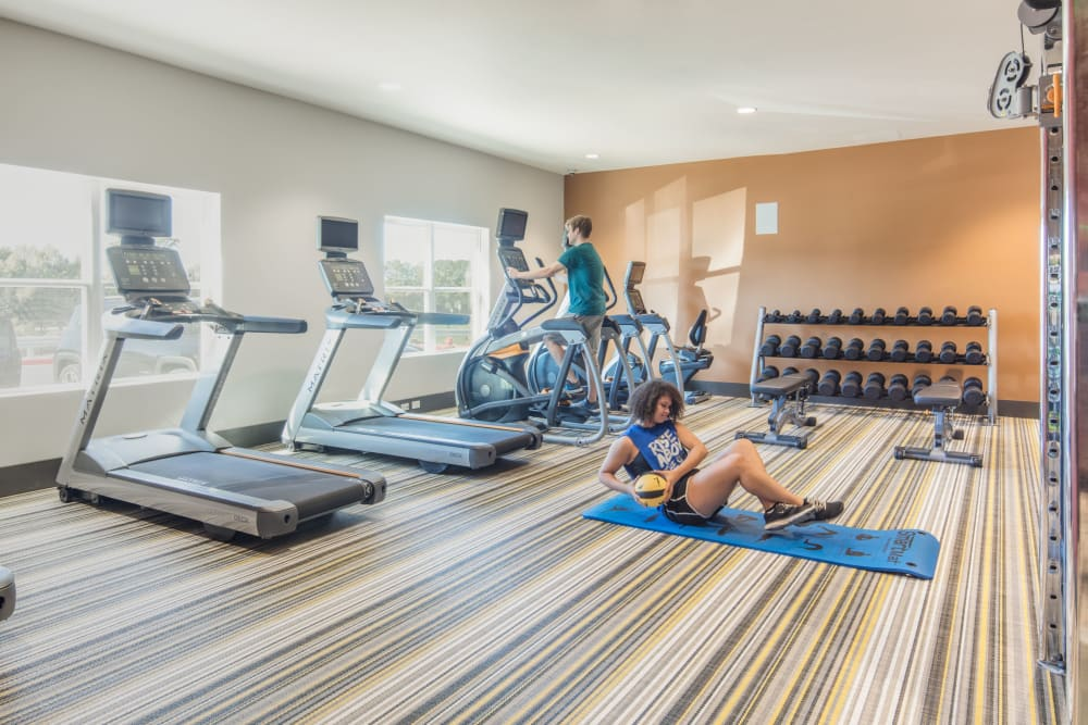 Fitness center with treadmills at evolve Tuscaloosa in Tuscaloosa, Alabama