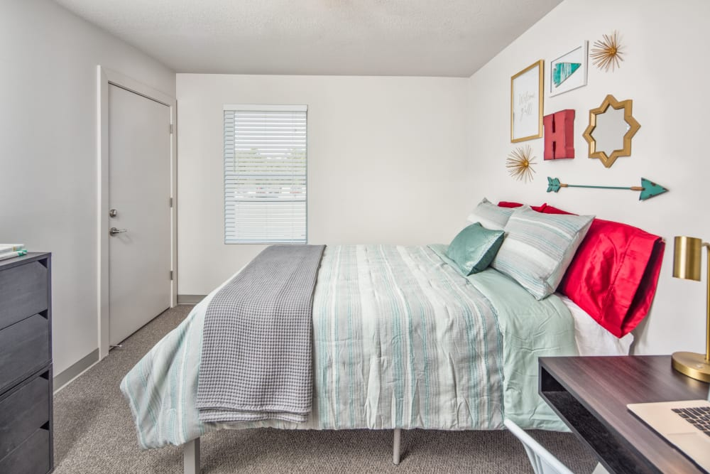 Cozy bedroom at evolve Tuscaloosa in Tuscaloosa, Alabama