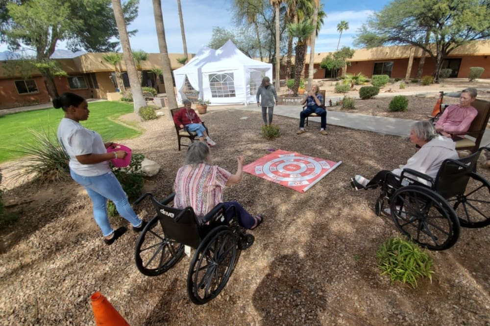 Residents having fun outside at Woodland Palms Memory Care in Tucson, AZ