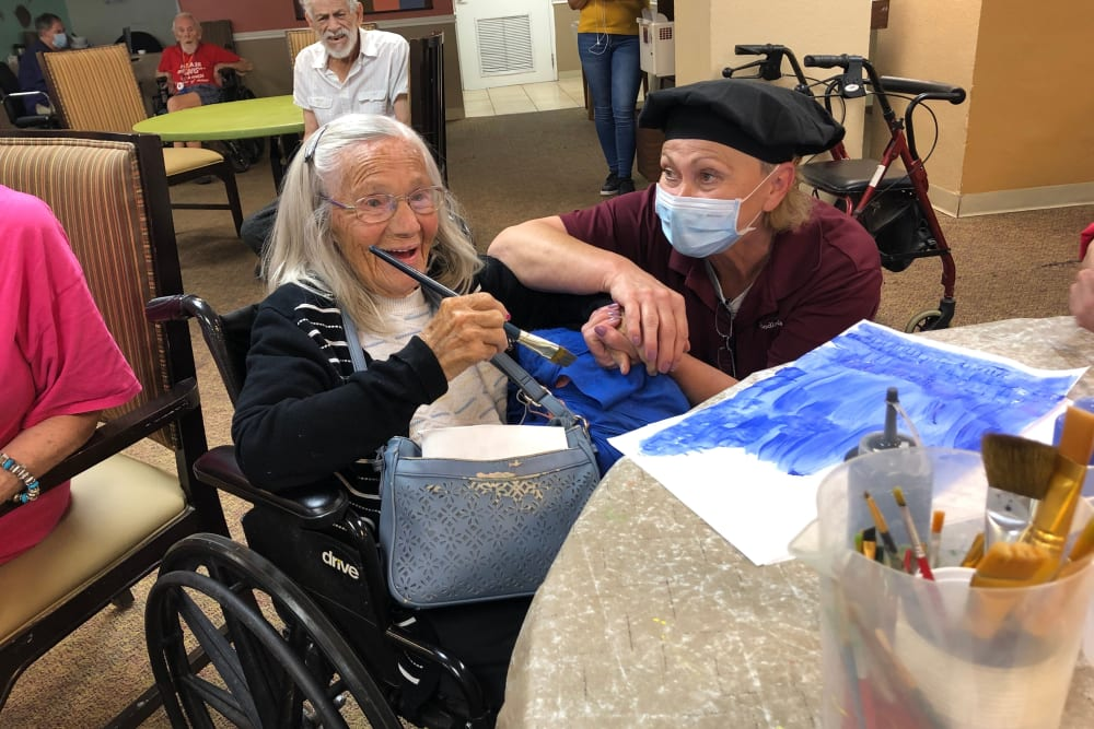 Painting pictures at Woodland Palms Memory Care in Tucson, AZ