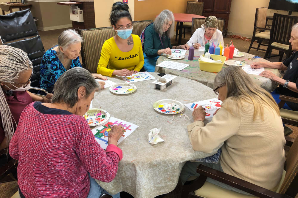 Having fun painting at Woodland Palms Memory Care in Tucson, AZ