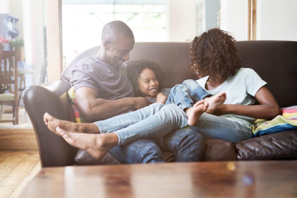 Family having fun in their new home at Avilla Eastlake in Thornton, Colorado