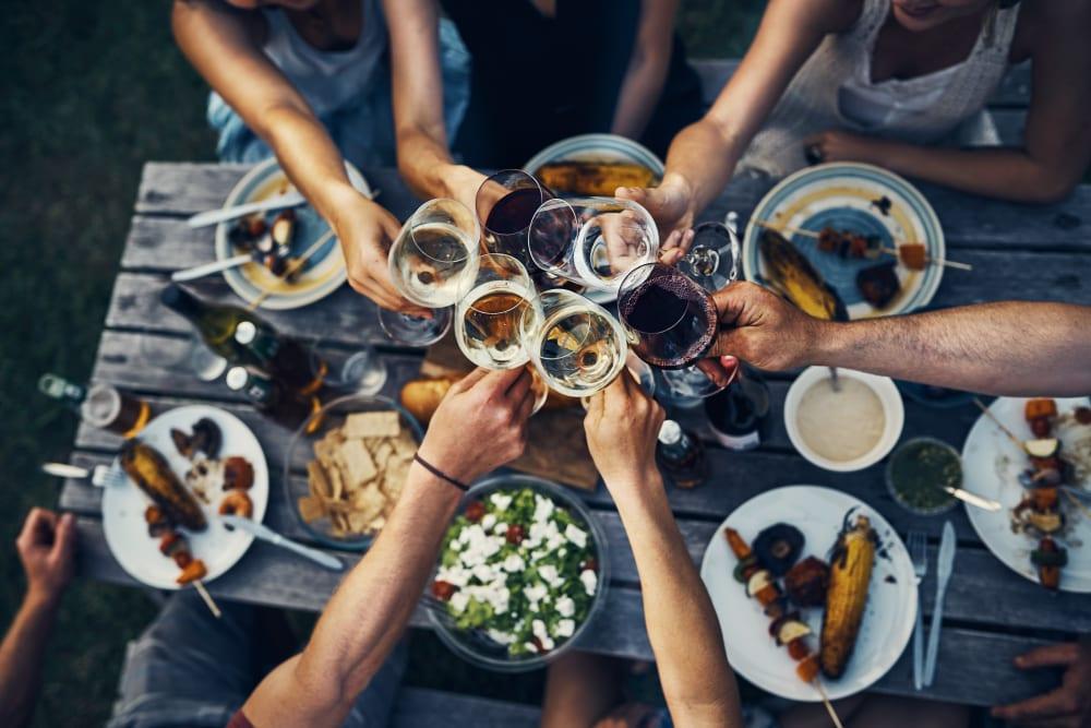 Residents enjoying happy hour at local restaurant near Avilla Eastlake in Thornton, Colorado