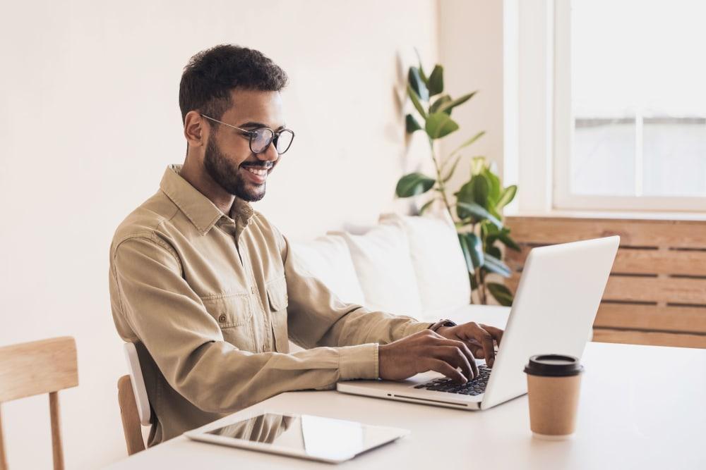 Resident doing homework on his laptop at evolve on Main in Pullman, Washington