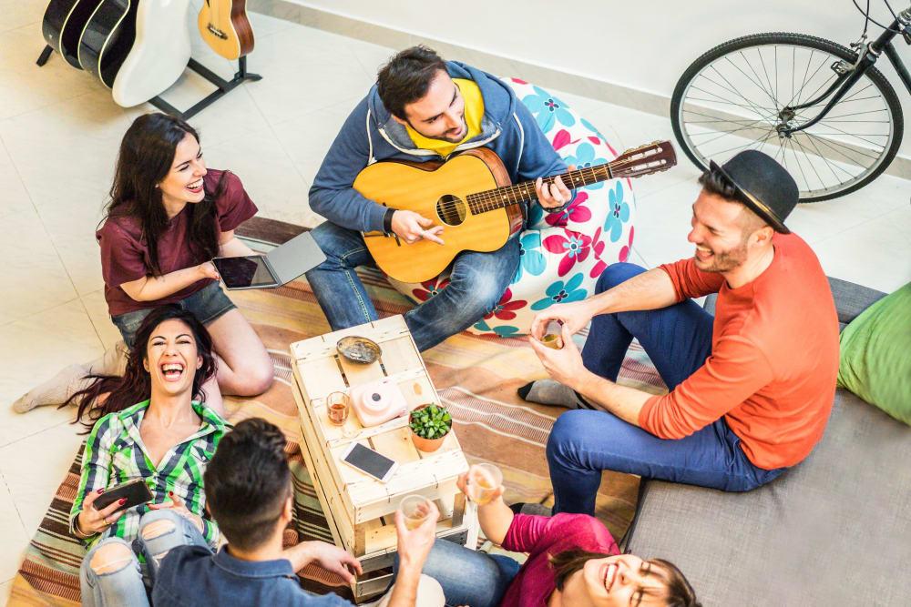 Friends enjoying a picnic near evolve on Main in Pullman, Washington