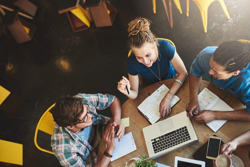 Classmates studying at a local cafe in Tuscaloosa, Alabama near evolve Tuscaloosa