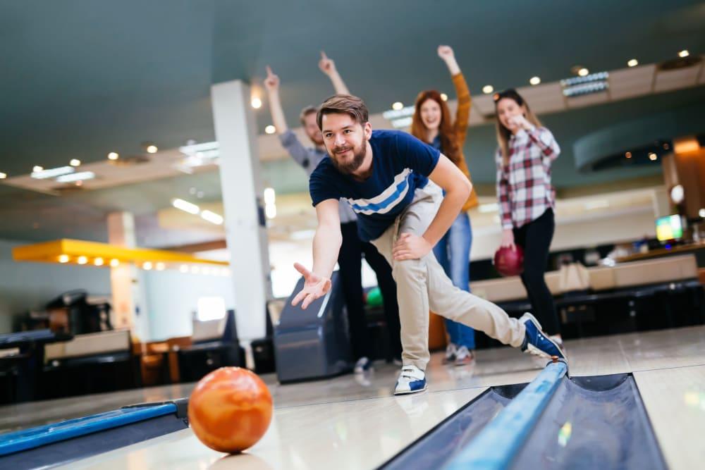 Residents bowling near HERE Minneapolis in Minneapolis, Minnesota
