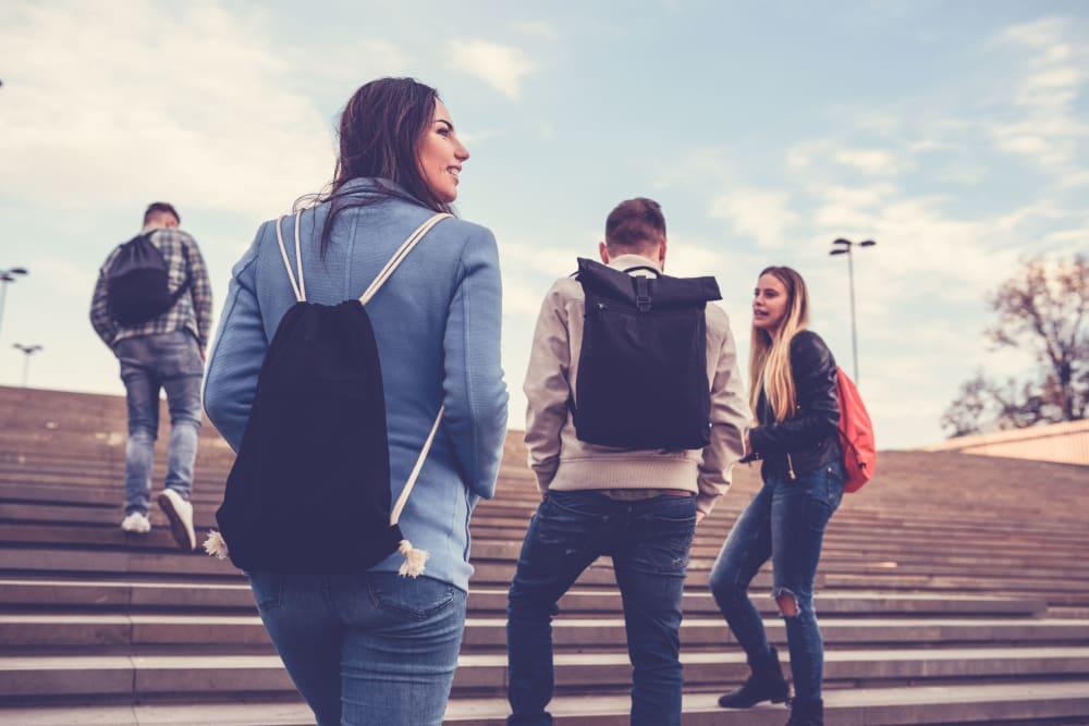 Friends walking to school in Lawrence, Kansas near HERE Kansas