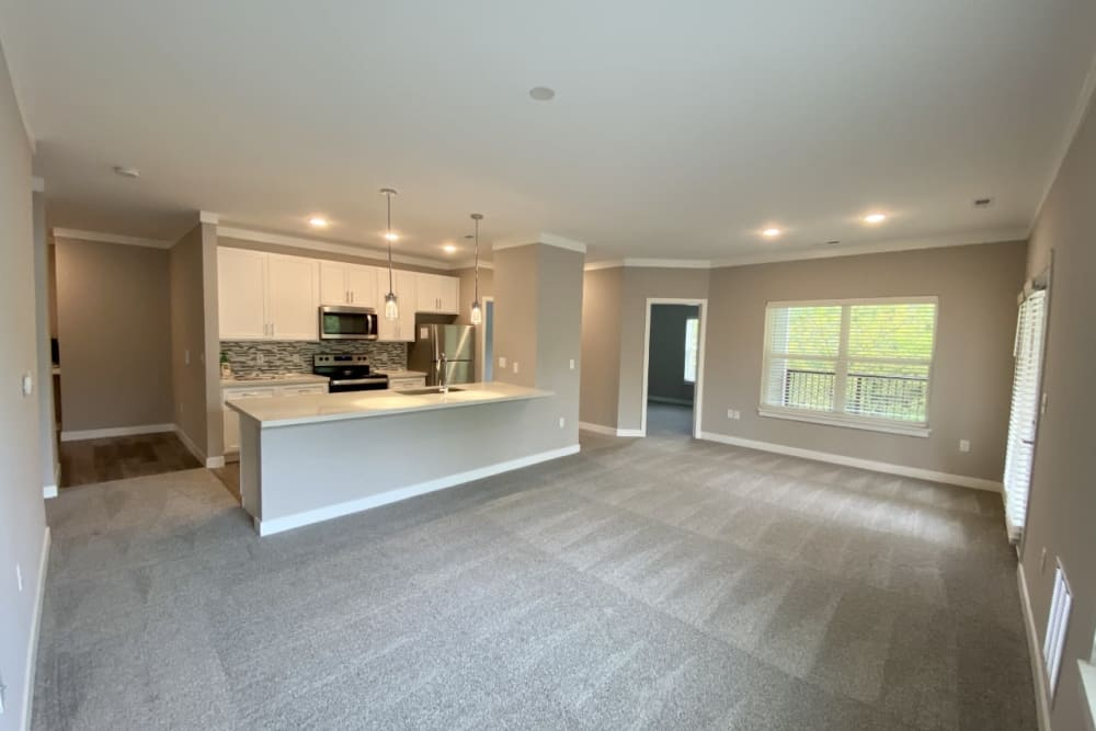 Modern kitchen featuring breakfast island and ample countertop space at Greyson on 27 in Nicholasville, Kentucky