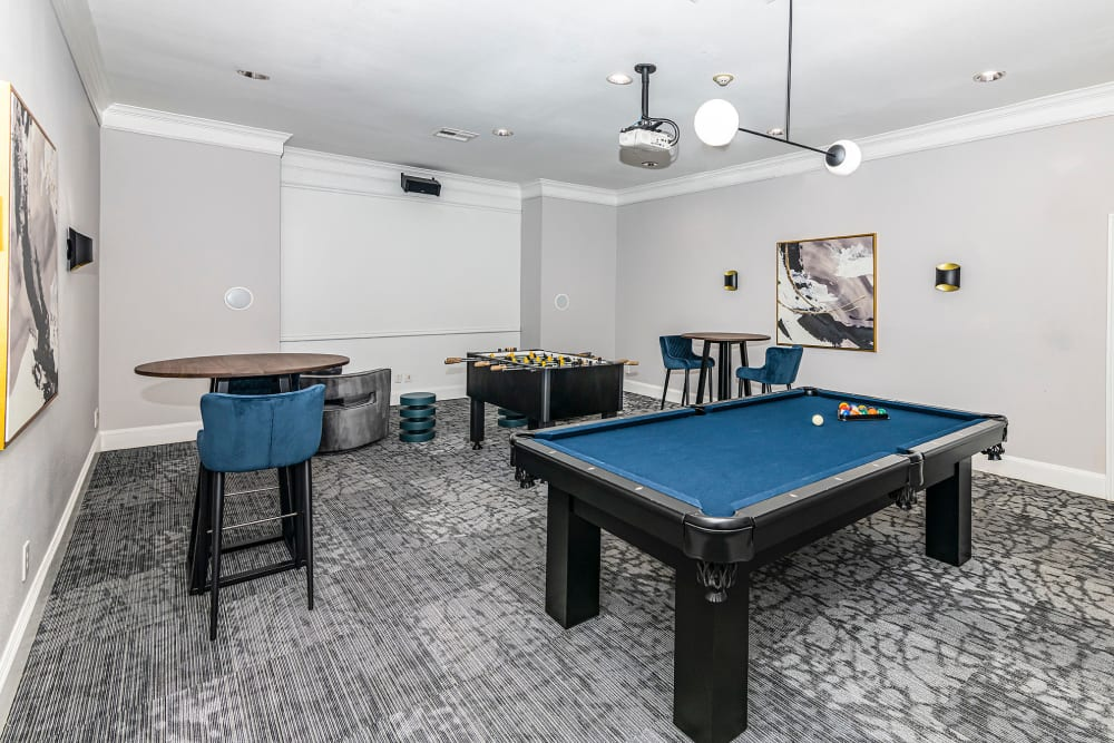 Pool table and other games in the clubhouse at The Lyndon in Irving, Texas