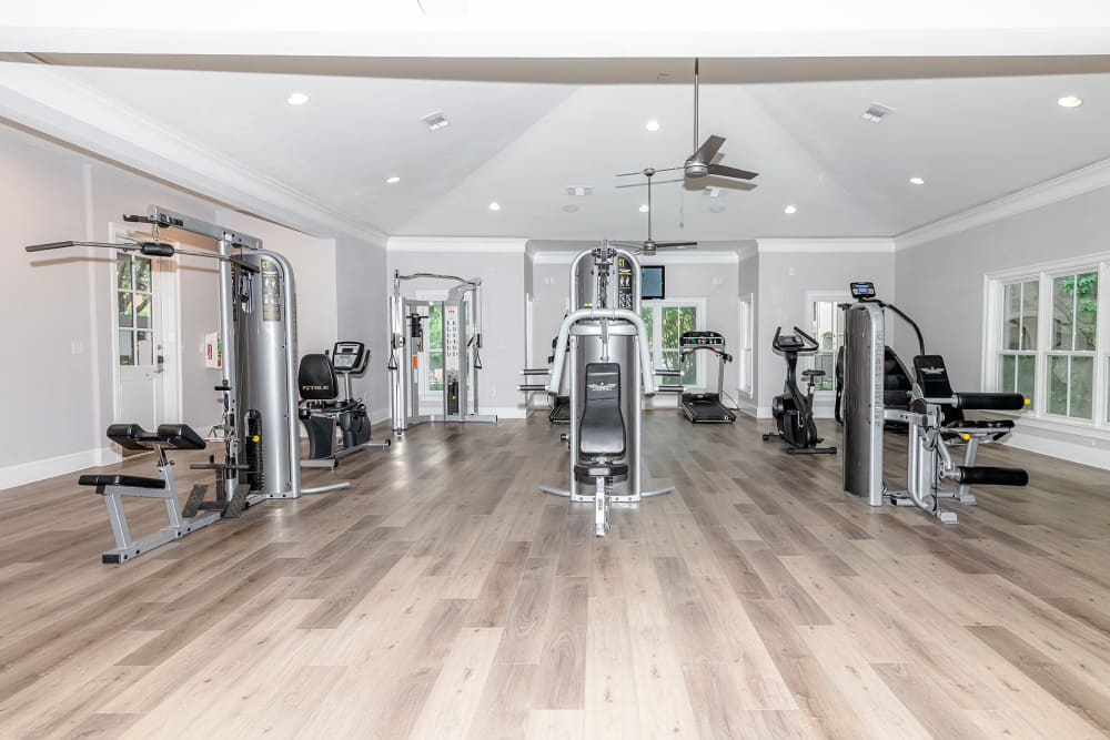 Well equipped fitness center with hardwood floors at The Lyndon in Irving, Texas