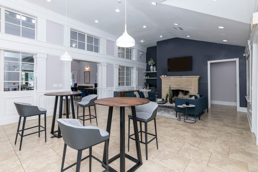 Clubhouse interior with barstools and fireplace at The Lyndon in Irving, Texas