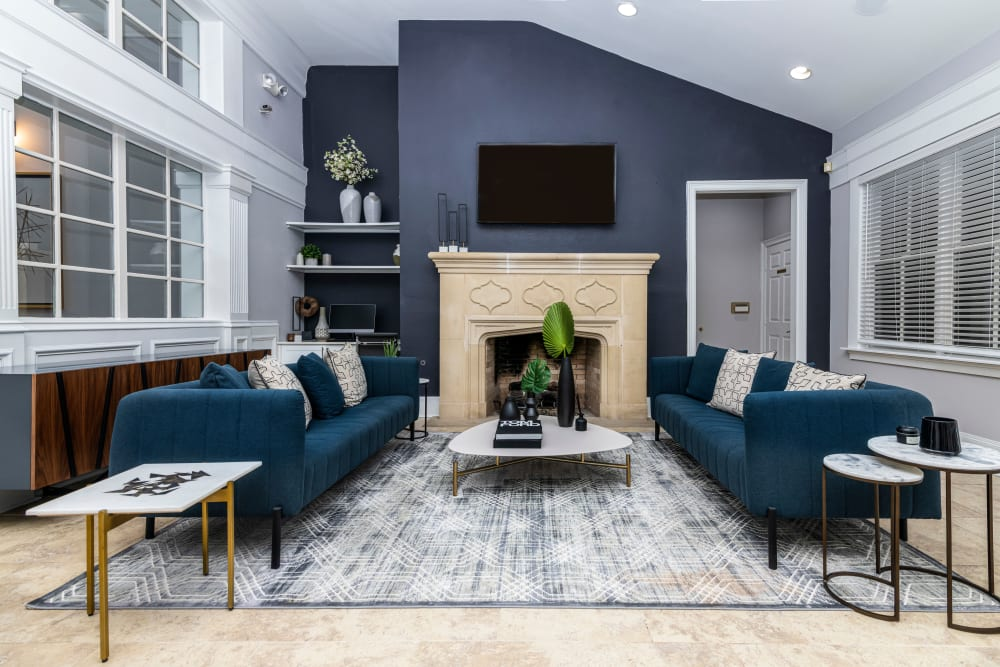 House interior with blue velvet couches and coffee table at The Lyndon in Irving, Texas
