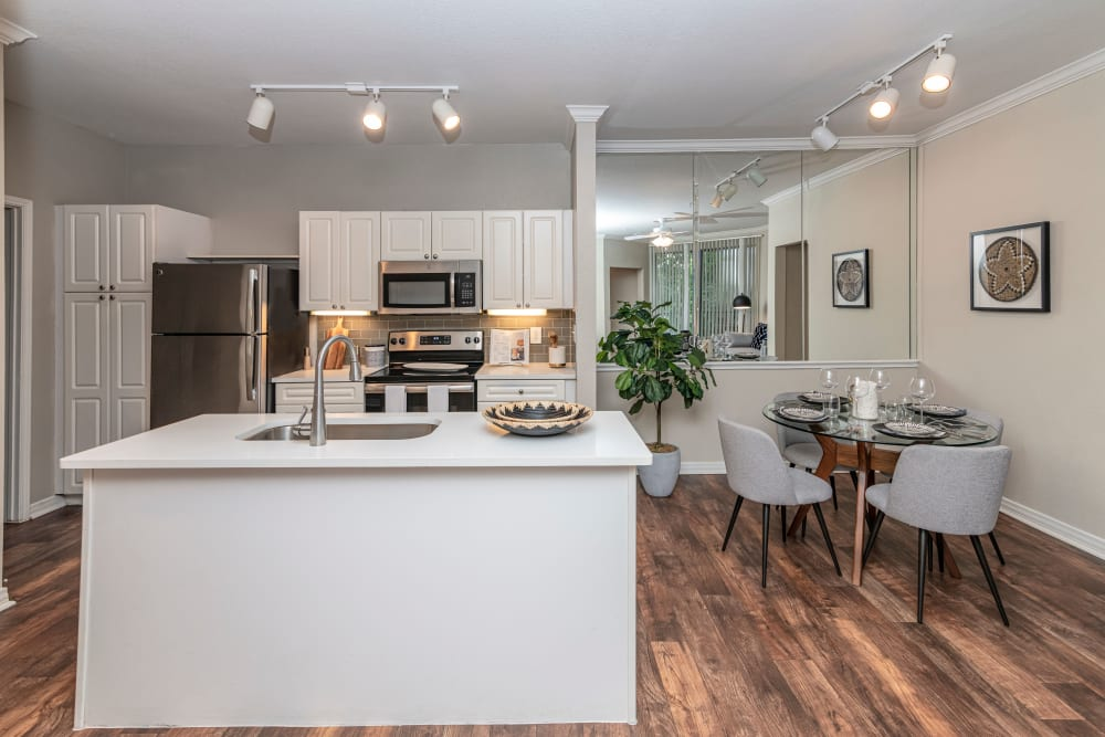View of kitchen in open concept floor plan at The Lyndon in Irving, Texas