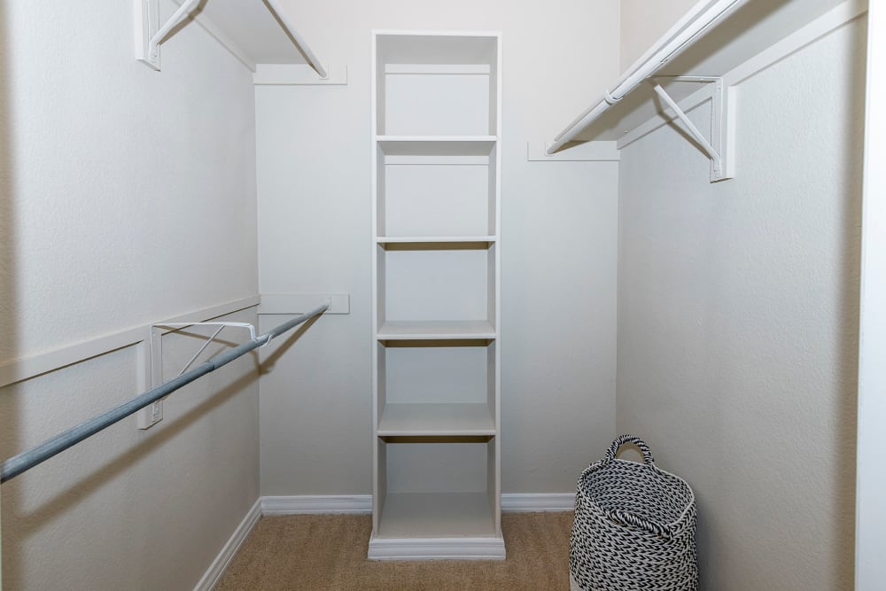 Walk in closet with woven basket hamper at The Lyndon in Irving, Texas