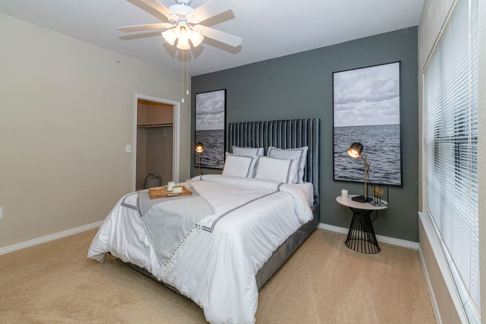 Well lit model bedroom at The Lyndon in Irving, Texas