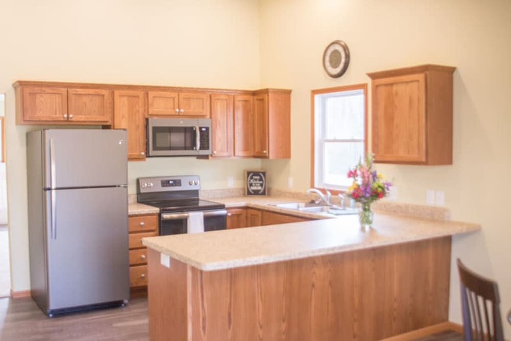 Kitchen in an independent living townhome at Arlington Place Oelwein in Oelwein, Iowa