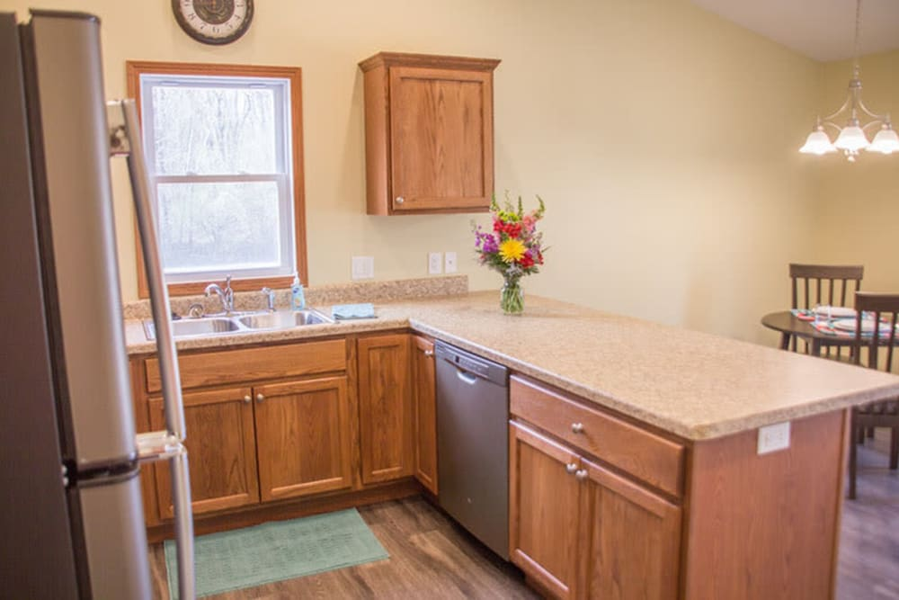 Kitchen and dining room in the townhomes at Arlington Place Oelwein in Oelwein, Iowa
