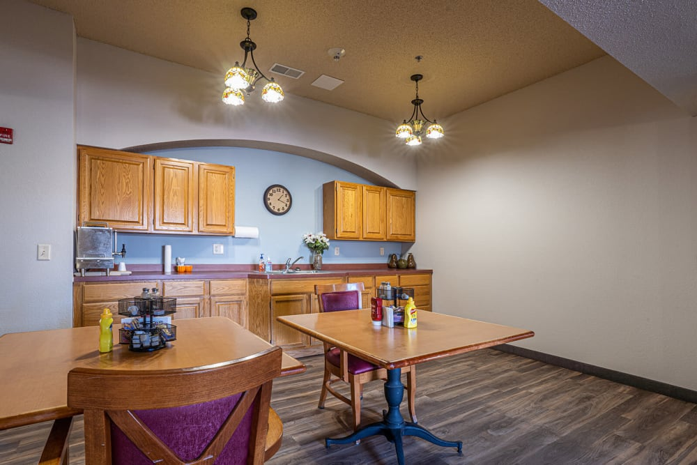 Small cafe with seating and a kitchenette at Traditions of Owatonna in Owatonna, Minnesota