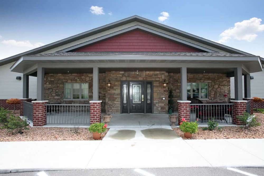 Side entrance to the community with a large covered patio at Traditions of Owatonna in Owatonna, Minnesota
