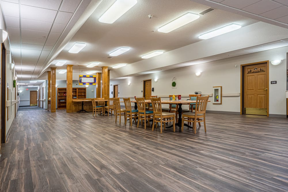 Wide open dining room connecting to resident homes at Traditions of Owatonna in Owatonna, Minnesota