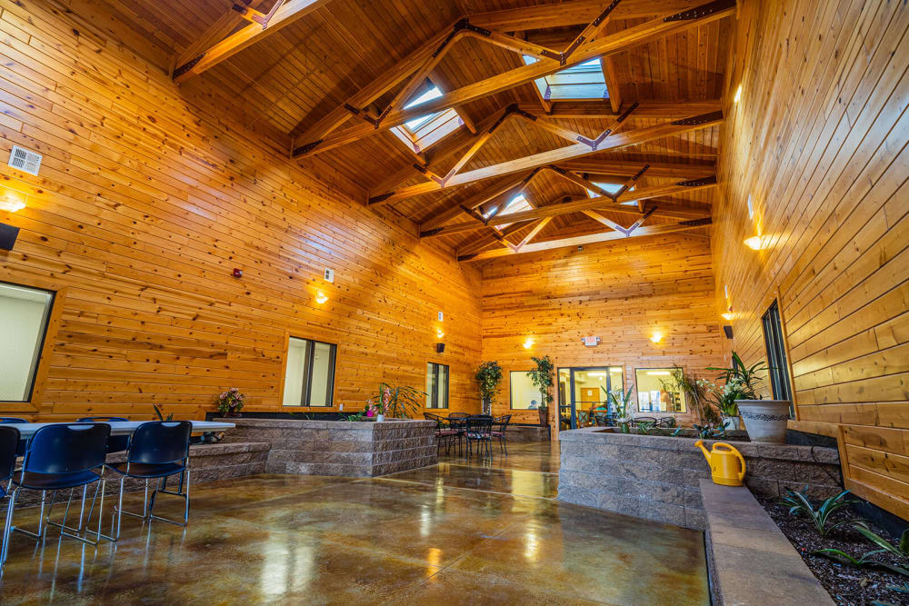 Wood room with beautiful orange lighting and plank walls at Traditions of Owatonna in Owatonna, Minnesota