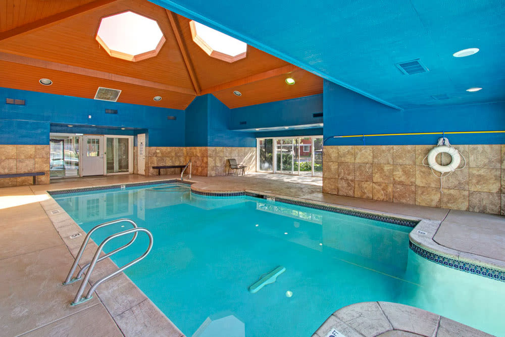 Large covered indoor pool at Overlook Point Apartments in Salt Lake City, Utah