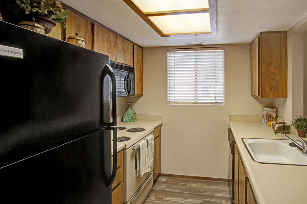 Model kitchen with black appliances and skylights at Overlook Point Apartments in Salt Lake City, Utah