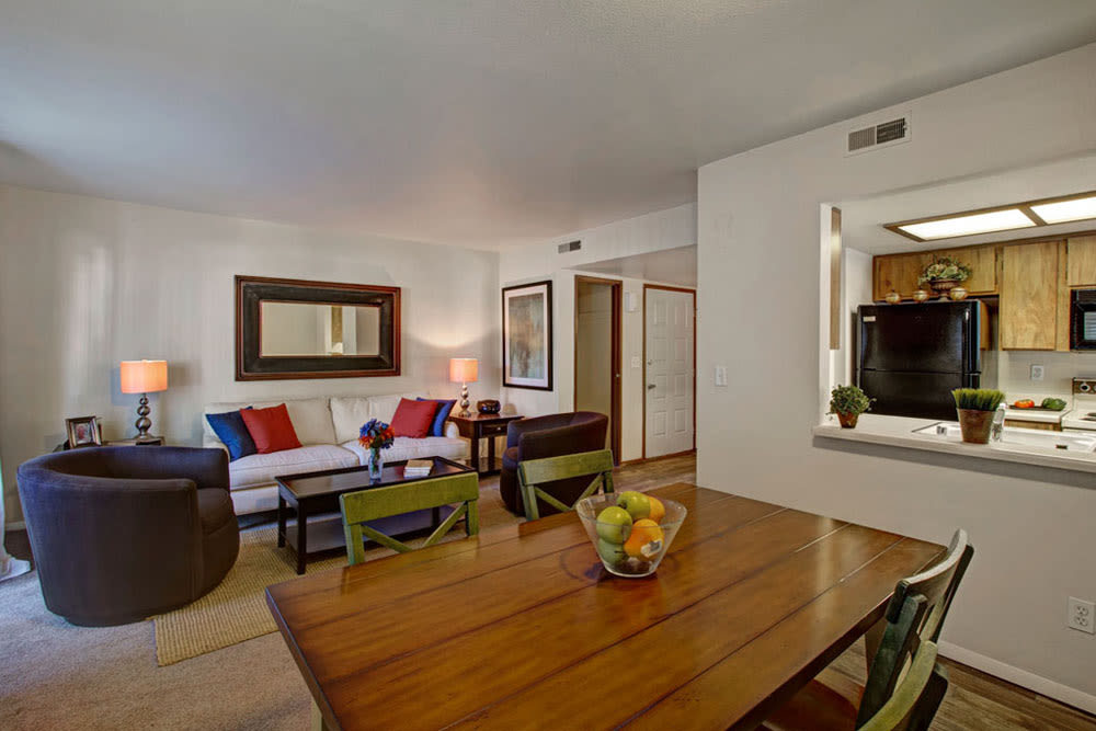 Dining nook with view of kitchen bar and living room in model unit at Overlook Point Apartments in Salt Lake City, Utah