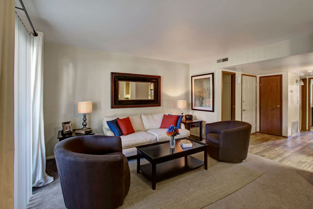 Well lit and well decorated model living room at Overlook Point Apartments in Salt Lake City, Utah