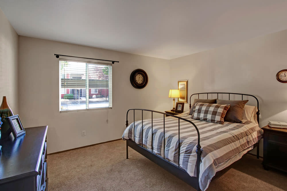 Well lit model bedroom at Overlook Point Apartments in Salt Lake City, Utah